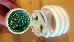 The green circuit board is the bottom of the ballast.  Notice the two wires coming from each end of the glass bulb.